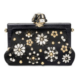 Black leather clutch with jewels on the front