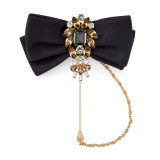 Brooch with black satin bow and jewels